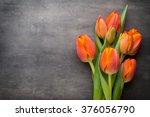 Orange Tulips On The Grey ...