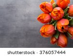 Orange Tulips On The Grey ...