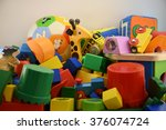 Small photo of Brightly Colored Blocky Toys of Made Of Fabric, Wood, and Plastic, In A Jumble On A White Background #2