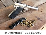 gun on the wooden background | Shutterstock . vector #376117060