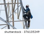 worker climbing on transmission ... | Shutterstock . vector #376135249