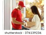 young woman receiving parcel... | Shutterstock . vector #376139236