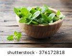 green fresh mint om the wooden... | Shutterstock . vector #376172818