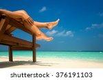 young woman sunbathing on... | Shutterstock . vector #376191103