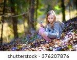 adorable little girl picking... | Shutterstock . vector #376207876