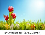 Easter Eggs And Tulips Flower...