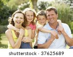 family relaxing in countryside | Shutterstock . vector #37625689
