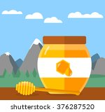 glass of honey with nice... | Shutterstock .eps vector #376287520