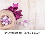 easter eggs and flowers over... | Shutterstock . vector #376311124