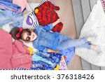 little girl and a lot of new... | Shutterstock . vector #376318426
