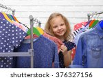 little girl trying on new... | Shutterstock . vector #376327156