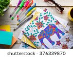 retro desk with adult coloring... | Shutterstock . vector #376339870