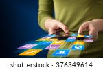 hand holding tablet device with ... | Shutterstock . vector #376349614