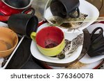 pile of dirty dishes in the sink | Shutterstock . vector #376360078