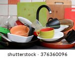 pile of dirty dishes in the sink   Shutterstock . vector #376360096