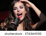 Portrait Of Beautiful Singing...