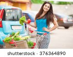 woman with vegetables in... | Shutterstock . vector #376364890