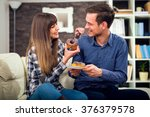attractive couple sitting on... | Shutterstock . vector #376379578