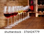 many glasses of different wine... | Shutterstock . vector #376424779