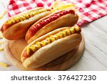 hot dogs with fried potatoes... | Shutterstock . vector #376427230