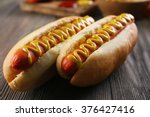 Hot Dogs On Wooden Background...