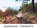 yong women in olive field... | Shutterstock . vector #376462270