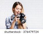 Woman Photographer Takes Image...