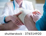 female doctor is rewinding knee ... | Shutterstock . vector #376514920