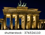Stock photo the floodlit brandenburg gate in berlin with a few fleeting shadows of anonymous berliner s 376526110
