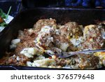 baked meatballs in a creamy... | Shutterstock . vector #376579648