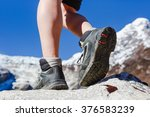 hiking boots on the rock in the ... | Shutterstock . vector #376583239