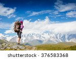 woman traveler with backpack... | Shutterstock . vector #376583368
