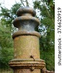 rusty antique iron gate post.... | Shutterstock . vector #376620919
