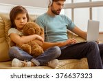 a sad little boy looking in... | Shutterstock . vector #376637323