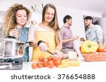 group of friends cooking at... | Shutterstock . vector #376654888