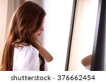 young woman looking herself...   Shutterstock . vector #376662454