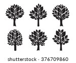 set of black trees and leafs.... | Shutterstock .eps vector #376709860