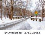 Snow Covers A One Lane Bridge...