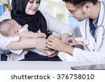 male pediatrician doing... | Shutterstock . vector #376758010