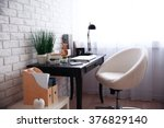 workplace with laptop on table... | Shutterstock . vector #376829140