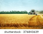 Combine Harvester Working On...