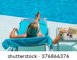 woman on vacation relaxing by... | Shutterstock . vector #376866376