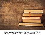 pile of books on wooden... | Shutterstock . vector #376933144