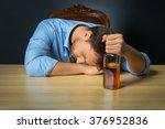 drunk man drinking alcohol at... | Shutterstock . vector #376952836