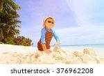 little boy building sandcastle... | Shutterstock . vector #376962208