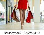 legs of shopaholic wearing red... | Shutterstock . vector #376962310