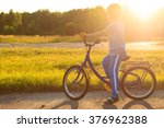 little boy riding bike at... | Shutterstock . vector #376962388