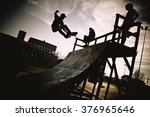 Skateboarder Jumping On A Ramp. ...