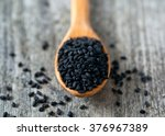 Black Cumin On Wooden Surface