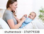 mother looks and playing with... | Shutterstock . vector #376979338